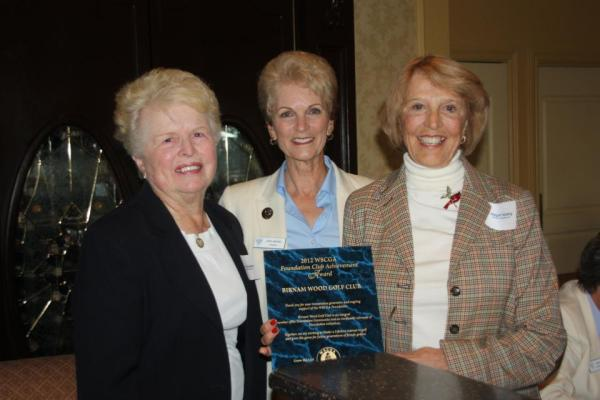 Jody Nickel presenting Foundation Club Achievement Award to Birnam Wood Golf Club representatives, Diane Wootton and Maylo Harding — at Glendora Country Club.